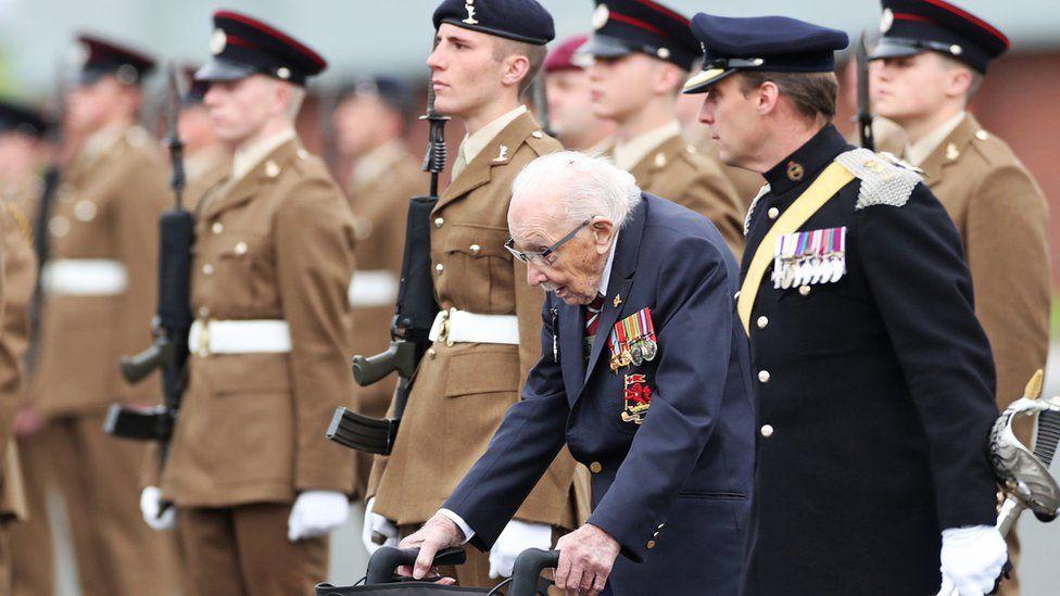 Captain Sir Tom Moore walking alongside junior soldiers