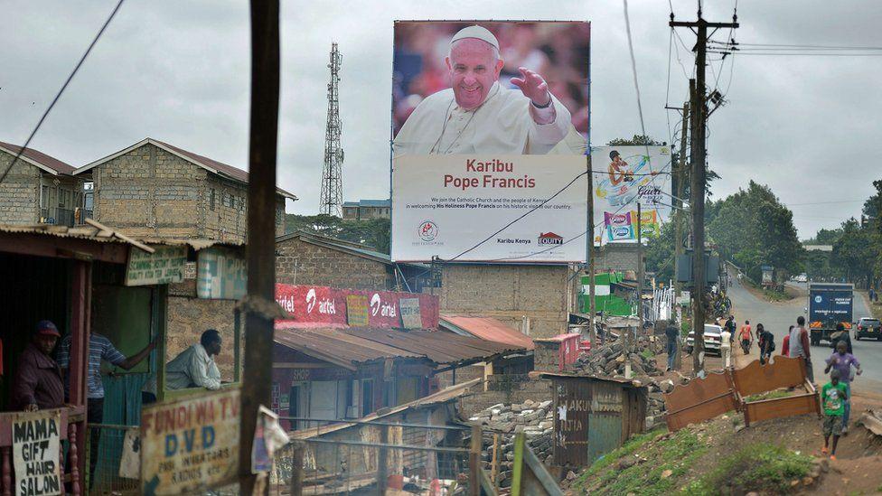 Pope poster in Kangemi slum, Kenya