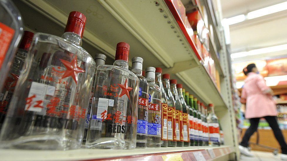 Bottles of baijiu are displayed at a store in Beijing