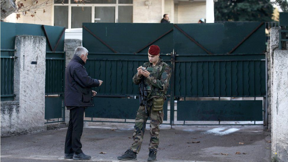 A French soldier secures the access to a Jewish school in Marseille's 9th district