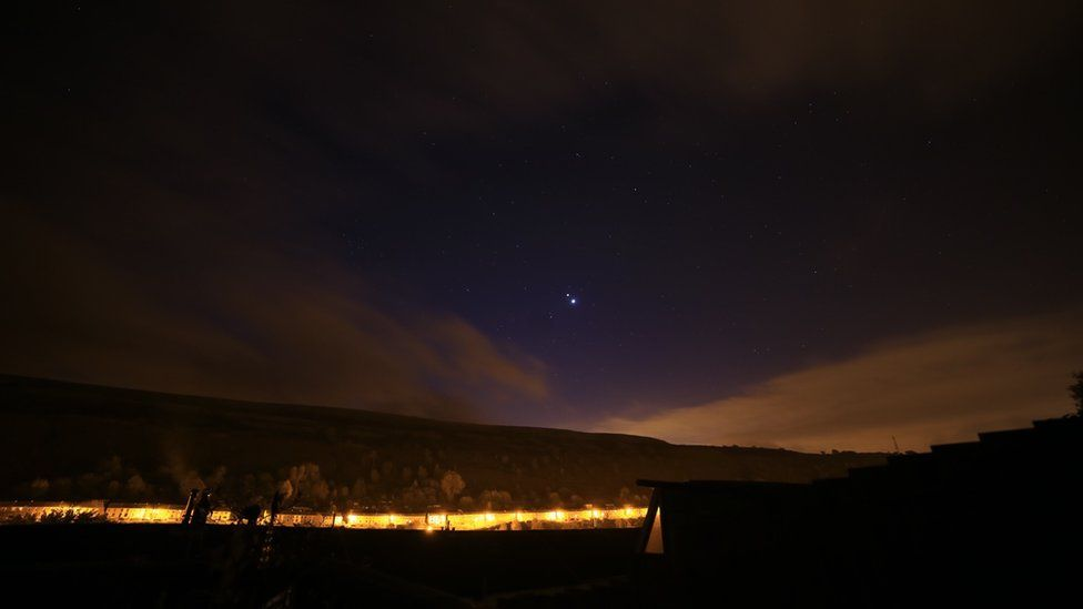 The planets seen from Rhonda in Wales L-R: Mars, bottom left, Jupiter and Venus