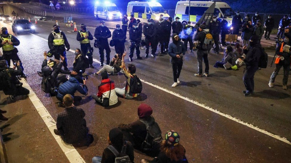 Police and protesters on the M32