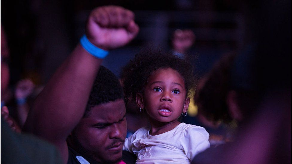 Families listening to Lift Every Voice