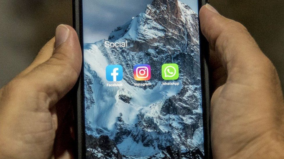 The icons of Facebook, Instagram, and Whatsapp are seen on a mobile phone on October 05, 2021