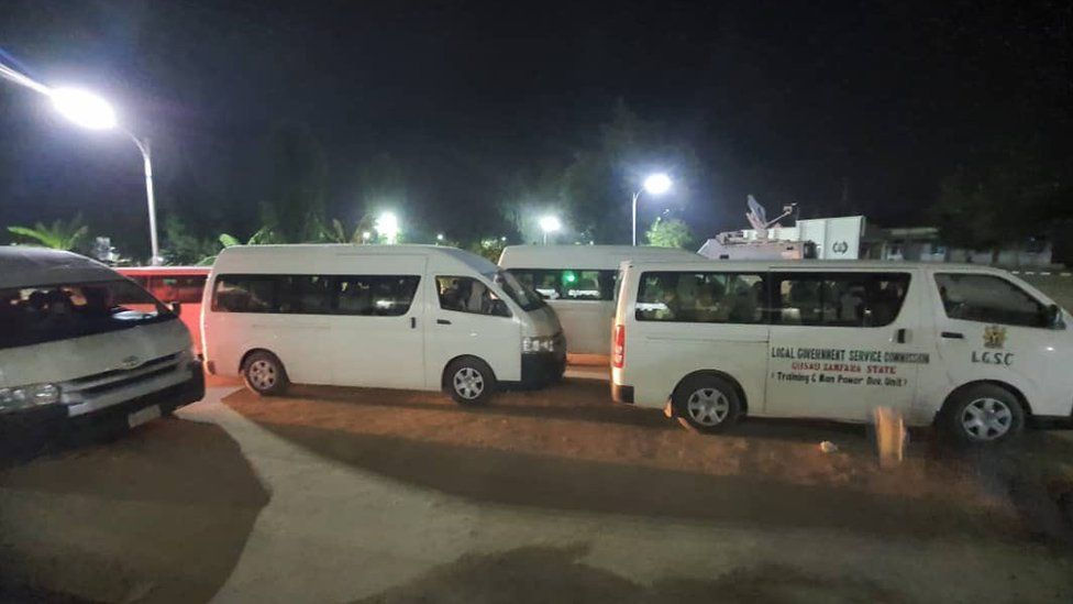 Image shows buses carrying the girls