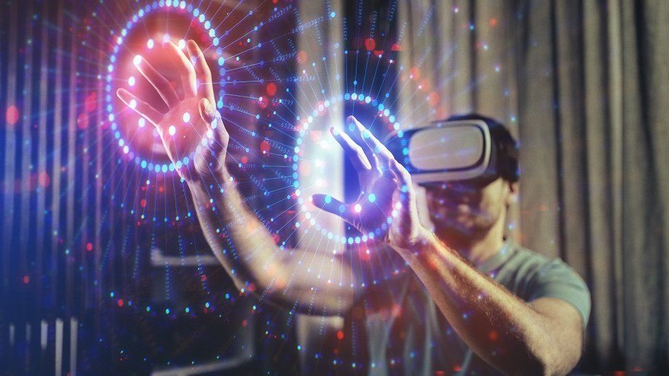 Man wearing VR headset and interacting with graphic