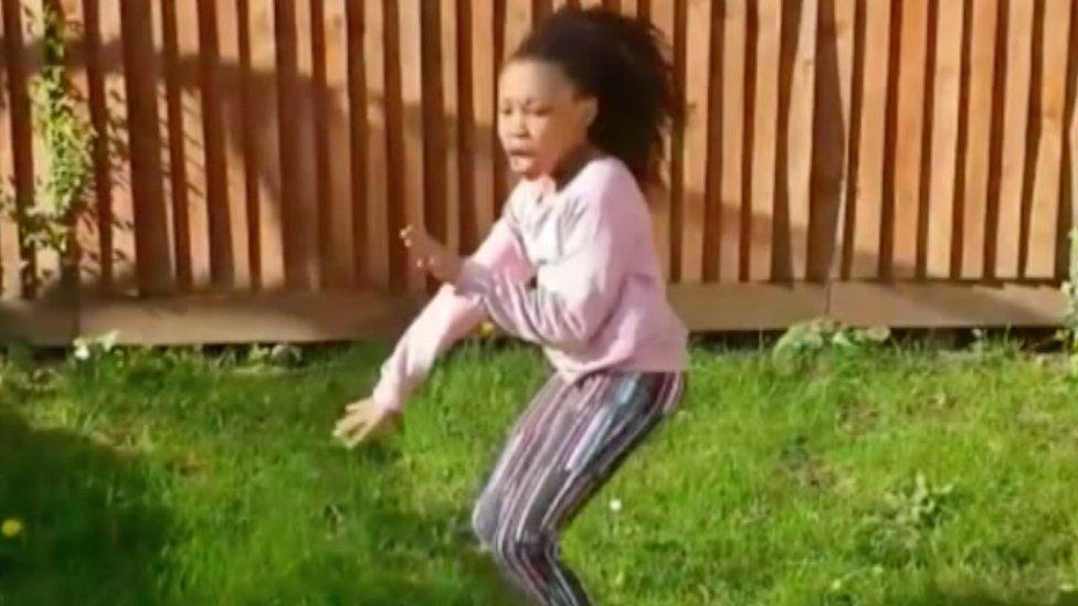 Girl dancing in a garden