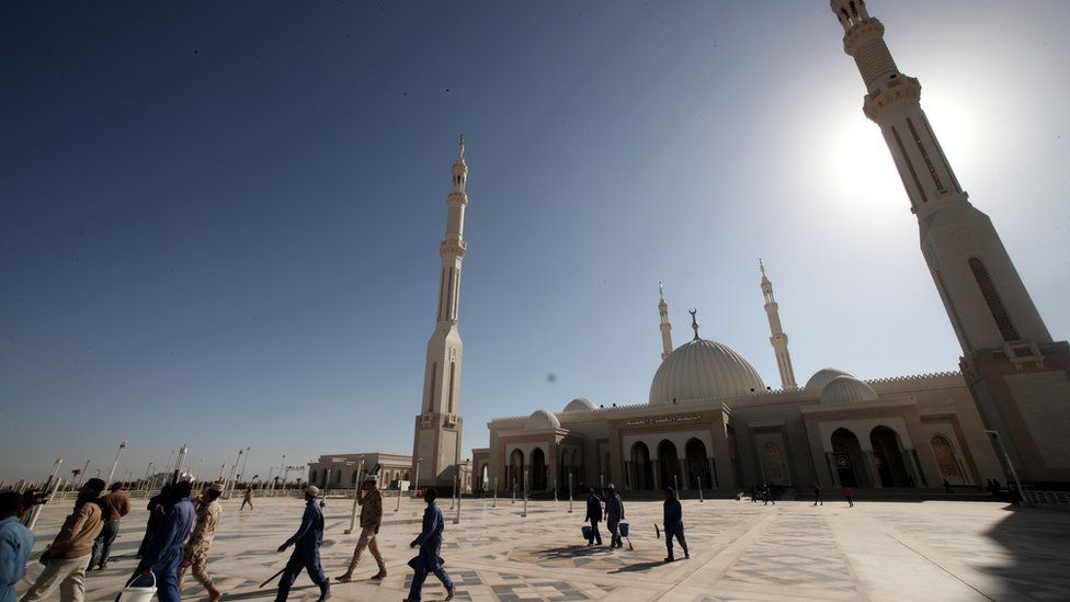 Labourers work outside the newly-constructed Al-Fattah Al-Alim mosque at the new administrative capital, 45km east of Cairo