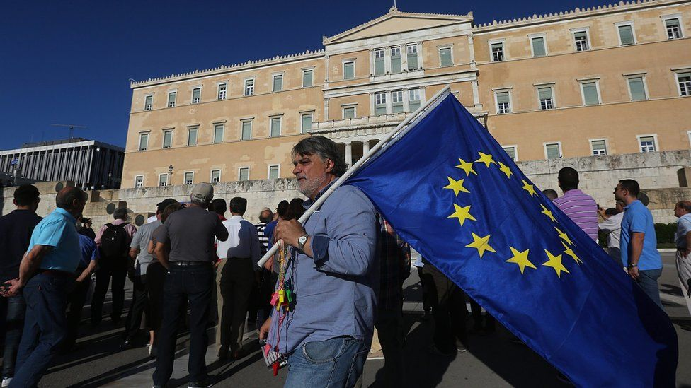 """Protesters take part in an anti-government rally organised by the """"Resign!"""" movement, outside the parliament in Athens, Greece, 15 June 2016"""