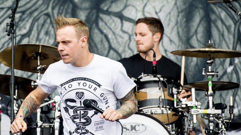 Drummer Dan Searle on stage with singer Sam Carter at Download Festival in 2013