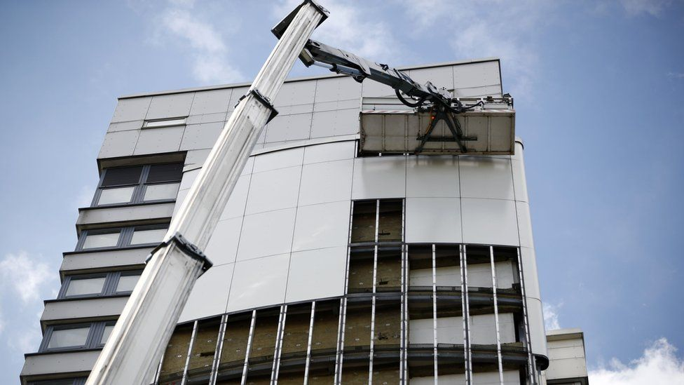 Cladding being removed from a tower block