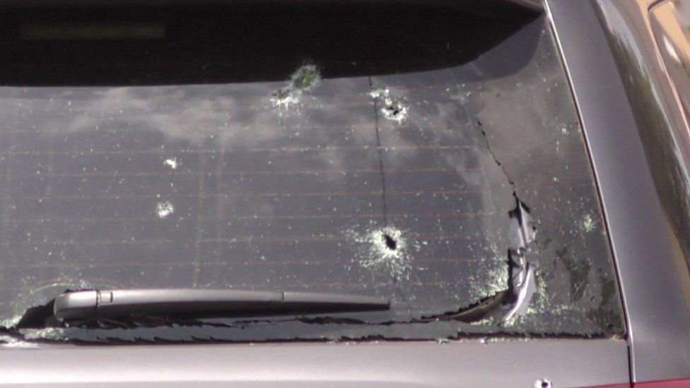 Bullet holes in the window of a vehicle