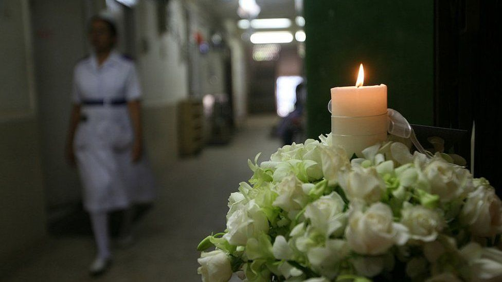 A candle being lit at Cama Hospital, one of the sites of last year's terror attacks in Mumbai on November 26, 2009.