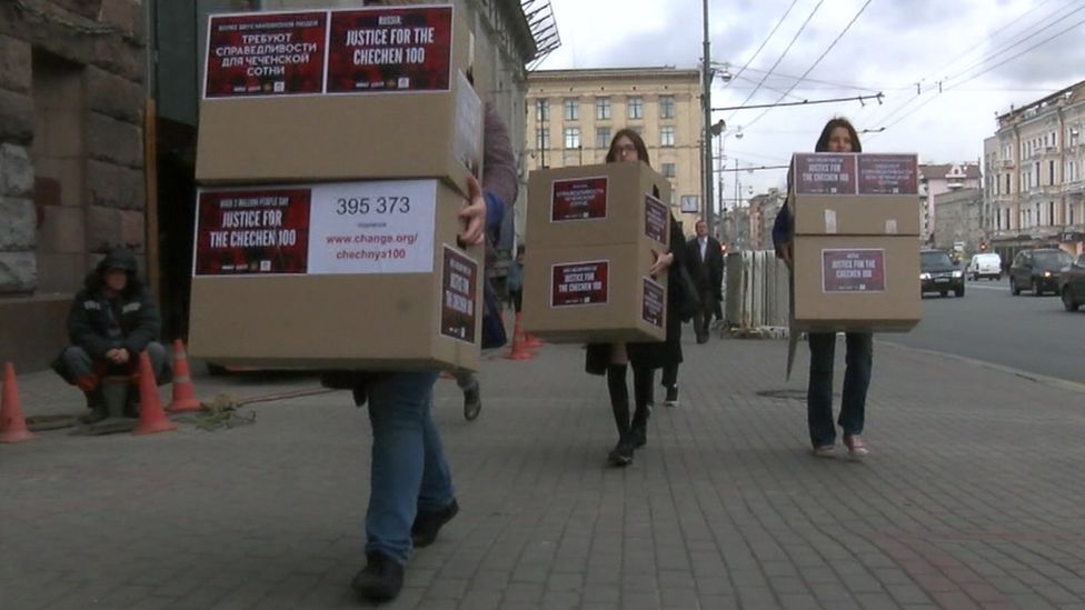 Gay rights activists carry empty boxes to the prosecutor general's office.