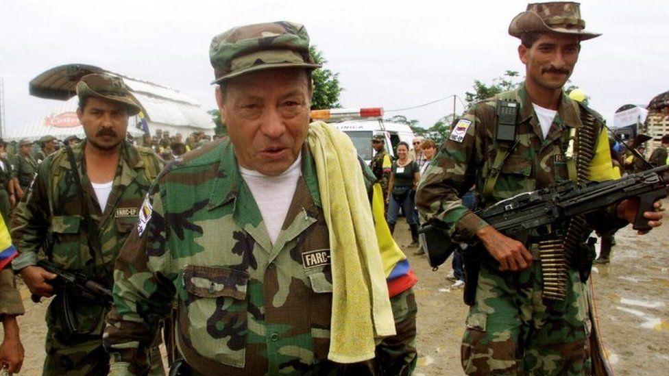 "Manuel ""Sureshot"" Marulanda Velez (C) of the Revolutionary Armed Forces of Colombia (FARC) walks in Villa Colombia camp near Caqueta province, Colombia, April 29, 2000"