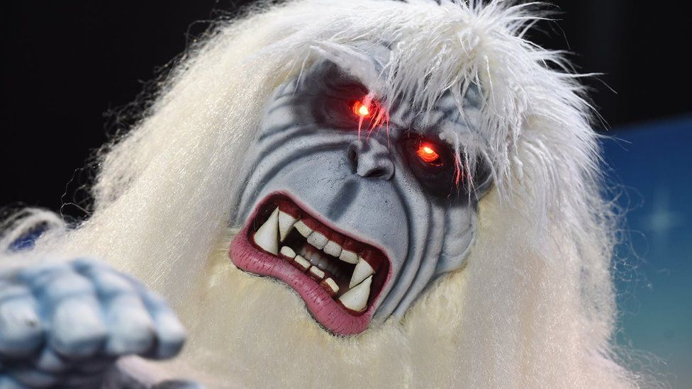 Bruce the Yeti celebrates after winning a costume competition at the Disney D23 EXPO 2015 held at the Anaheim Convention Center in Anaheim, California on August 14, 2015