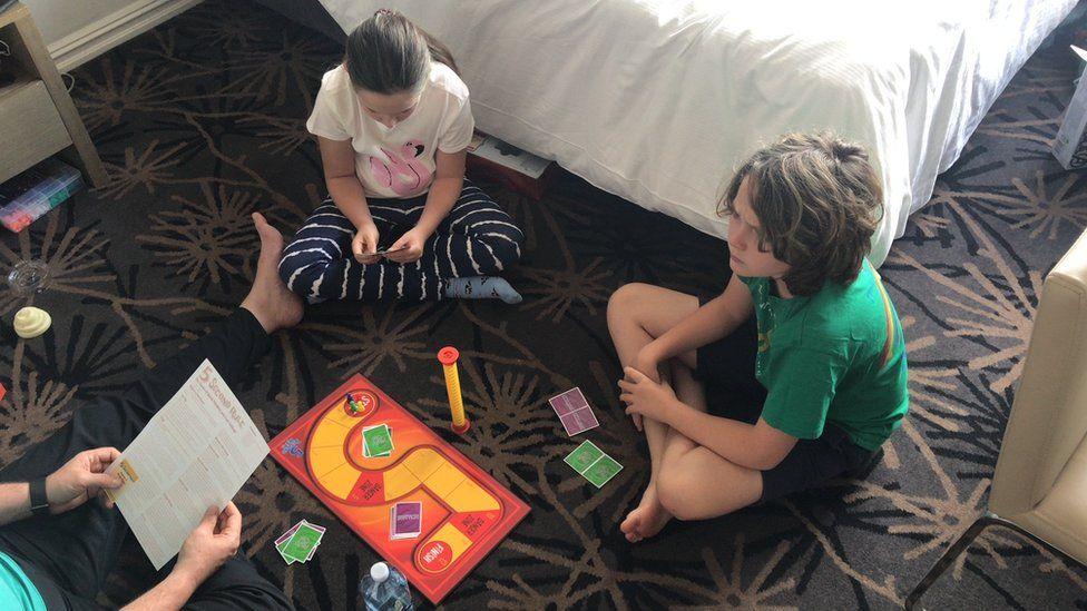 Keri Mcmenamin's children Quinn and Nyala play board games