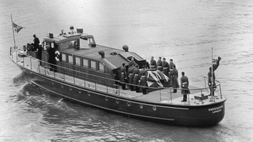 The coffin of British Prime Minister Winston Churchill on board the barge Havengore at Tower Pier