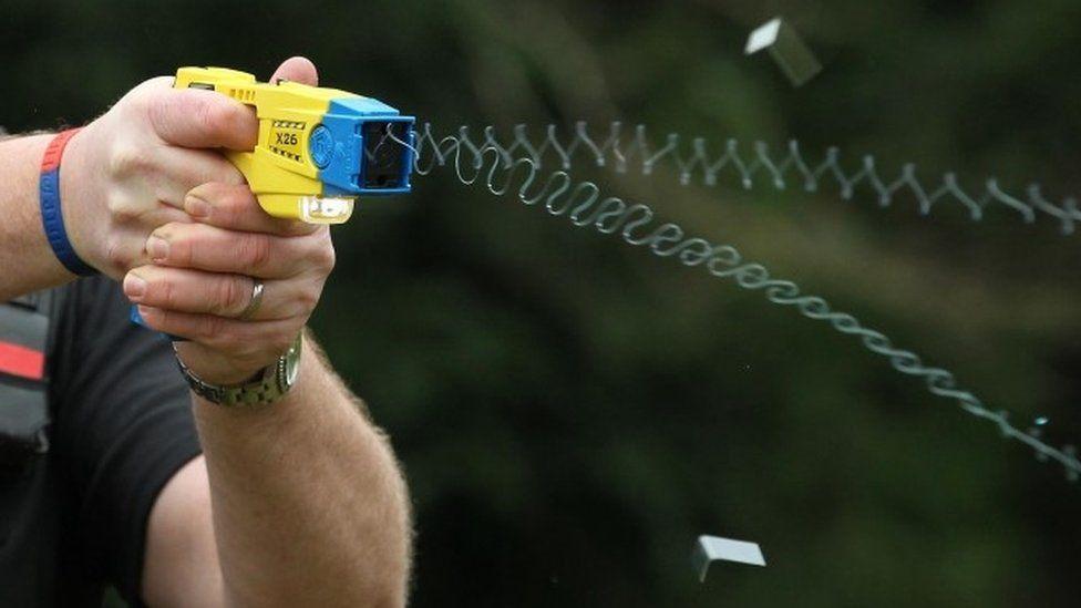 Close-up of a Taser gun being fired