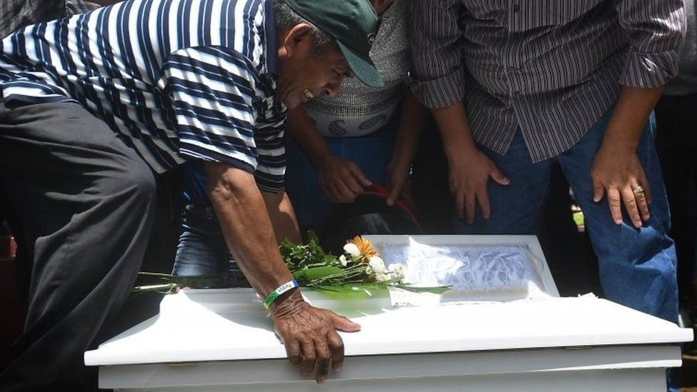 Relatives of 15-month-old Teiler Lorio, who died during an attack by riot police and members of the Sandinista Youth, cries during her son's funeral at the Milagro de Dios cemetery in Managua on June 24, 2018.