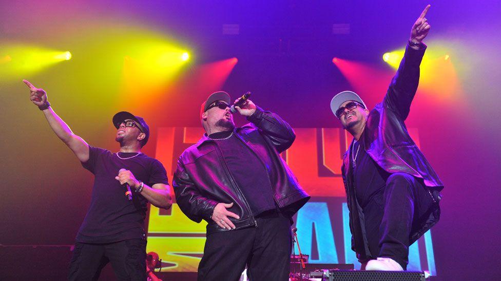 Adam Emil, Bryan Abrams and Mark Calderon of Color Me Badd performing in 2017