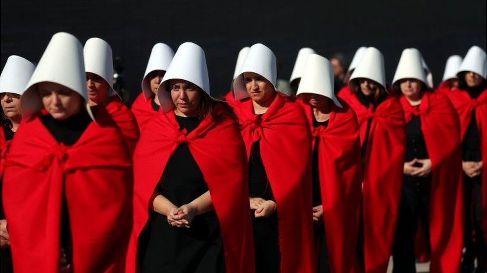 """Activists dressed up as characters from """"The Handmaid's Tale"""" take part in a demonstration in favour of legalising abortion in Buenos Aires, Argentina, August 5, 2018"""