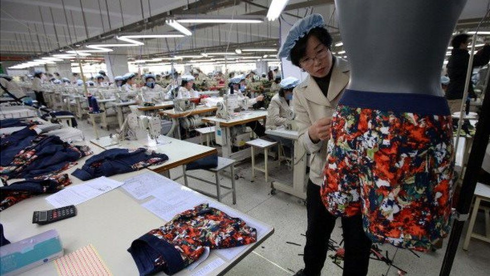 North Korean employees work at the assembly line of the factory of South Korean company at the Kaesong industrial complex on December 19, 2013 in Kaesong, North Korea.