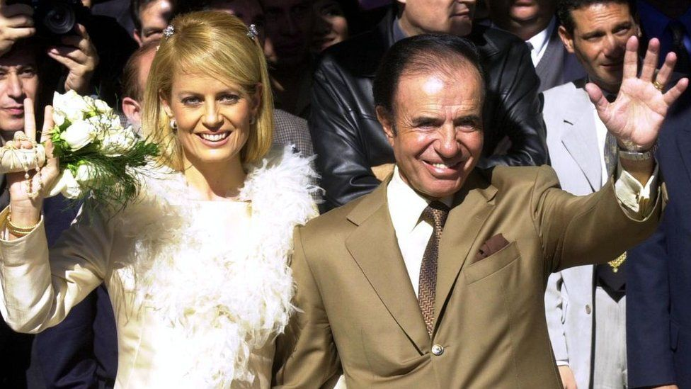 Former Argentine president Carlos Menem, 70, and his bride, the Chilean former Miss Universe Cecilia Bolocco, 36, wave following their wedding vows in a civil ceremony 26 May 2001