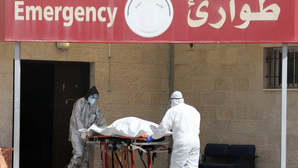Body being wheeled into a hospital in Nablus
