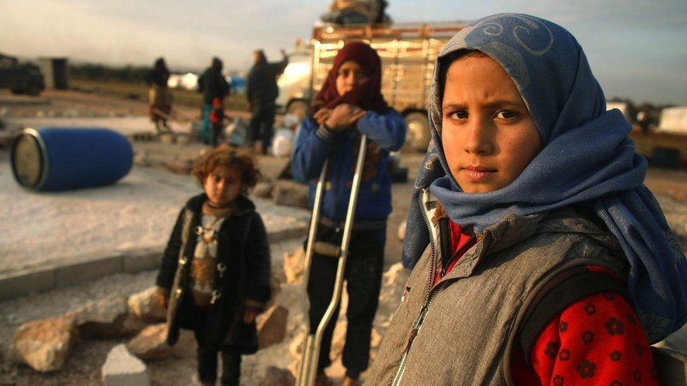 File photo showing displaced Syrian children at a camp in Idlib province on 16 February 2020