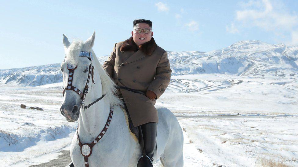 North Korean leader Kim Jong Un riding a white horse amongst the first snow at Mouth Paektu.