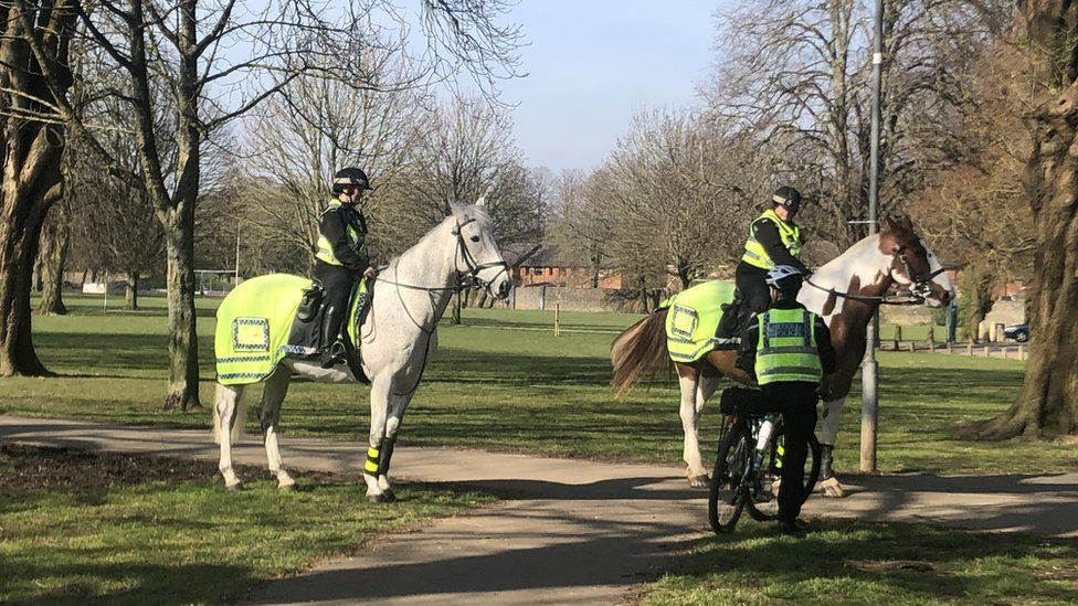 police on horses and bicycle on patrol in Cardiff