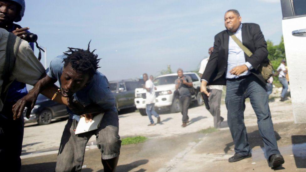 Senator Jean Marie Ralph Féthière brandishing a gun outside the Haitian parliament, Port-au-Prince (23 Sept)