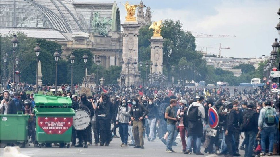 Protesters gather during a demonstration against proposed labour reforms near the Grand Palais, in Paris on June 14, 2016