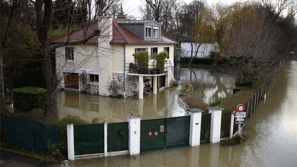 A photo taken on 29 January 2018 shows a house surrounded by floodwater from the Seine river in Bougival, west of Paris