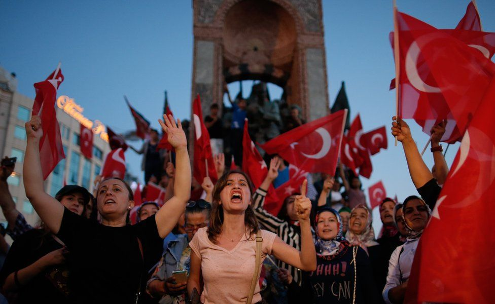 """People chant slogans as they gather at a pro-government rally in central Istanbul""""s Taksim square, Saturday, July 16, 2016."""