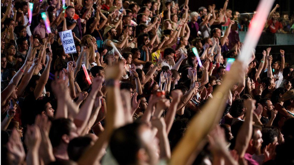Unidos Podemos (United We Can) supporters cheer as their leader Pablo Iglesias speaks on stage after the elections results on 26 June 2016 in Madrid, Spain.