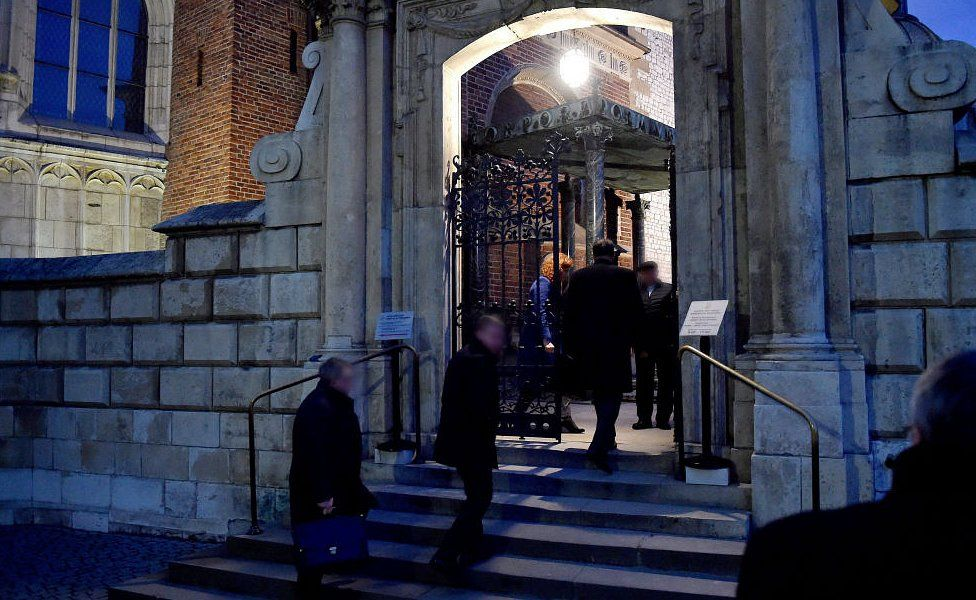 Members of exhumation team enter crypt at the Wawel Cathedral in Krakow, Poland, 14 November 2016