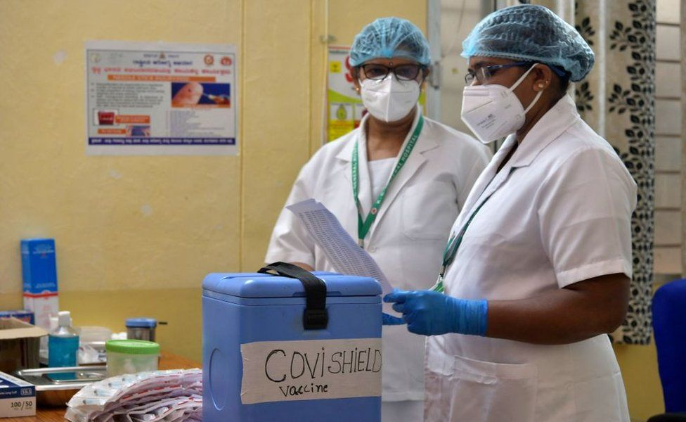 Nurses prepare to administer a Covid-19 coronavirus vaccine to health workers at the KC General hospital in Bangalore on January 16, 2021.