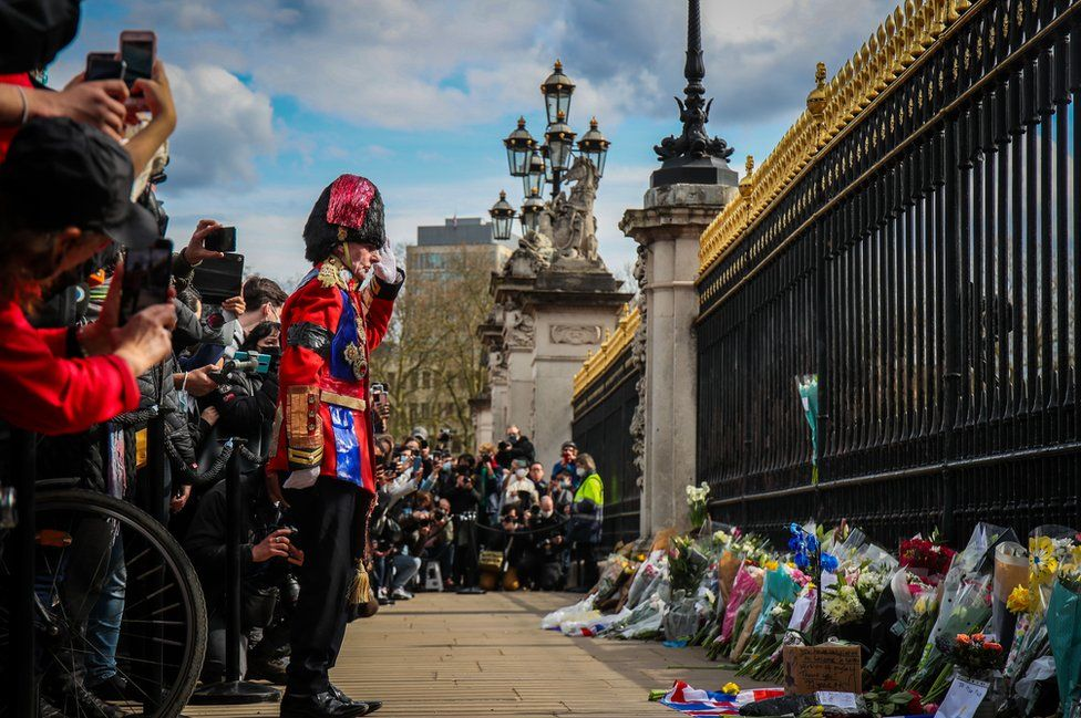 Mourners lay flowers outside Buckingham Palace following the announcement of the death of The Prince Phillip, Duke of Edinburgh