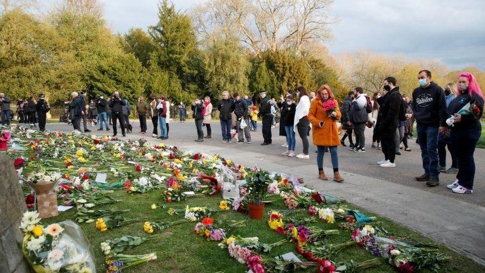 People gather outside Windsor Castle after Prince Philip's death