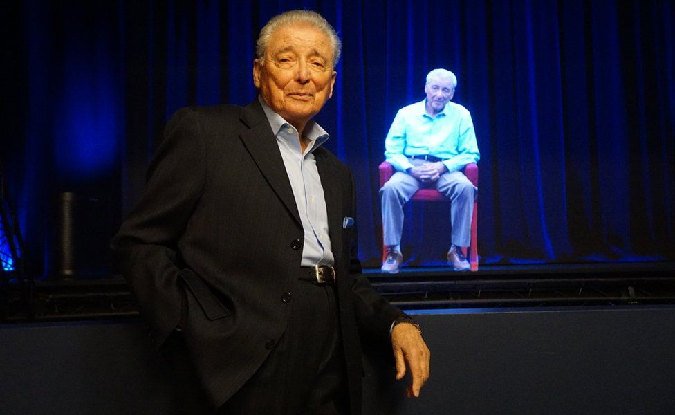 A Holocaust survivor with his avatar at the Shoah Foundation