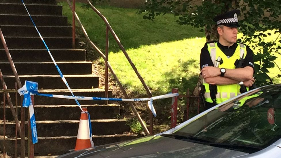 Policeman outside cordoned off flat