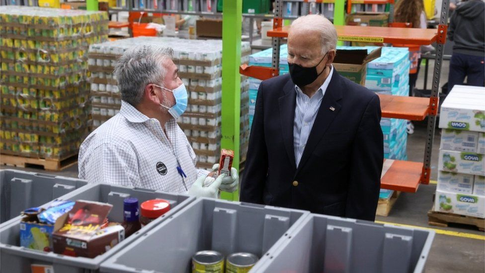 Mr Biden toured the Houston Food Bank, the largest food bank in the nation