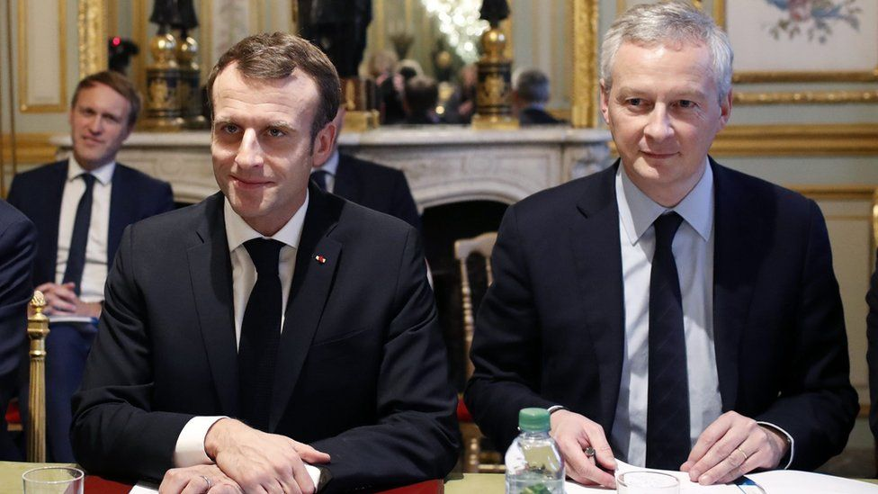 President Emmanuel Macron with Finance Minister Bruno Le Maire on 11 December 2018