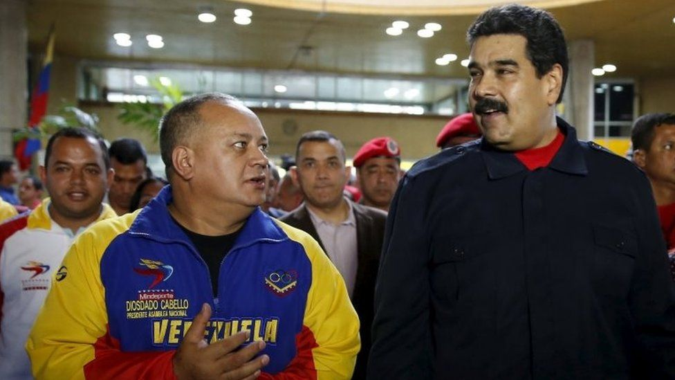 Nicolas Maduro (right) speaks to the President of the National Assembly Diosdado Cabello, after a ceremony at the National Electoral Council headquarters in Caracas on 26 October , 2015