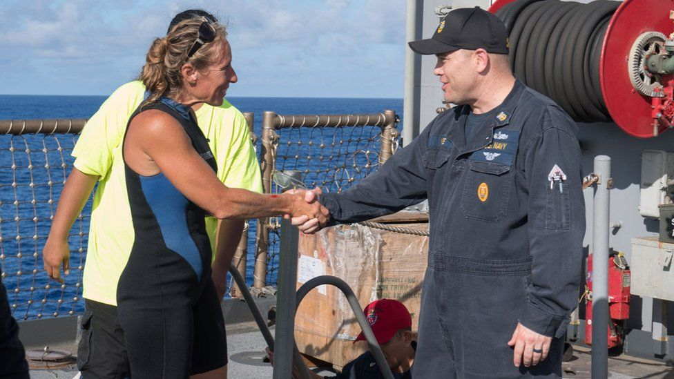 Jennifer Appel is welcomed on board the USS Ashland by Command Master Chief Gary Wise, 25 October 2017