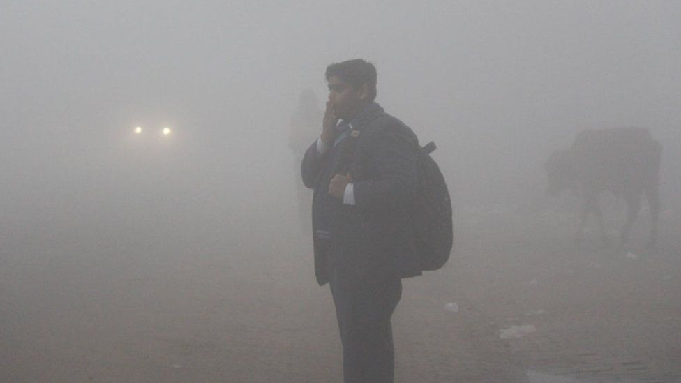 Students are seen wearing warm clothes to school amid dense fog on a cold winter morning, on December 30, 2019 in Gurugram, India.