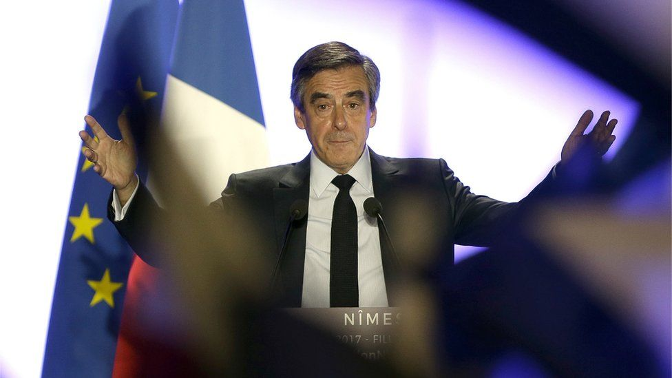 Conservative presidential candidate Francois Fillon gestures as he delivers his speech in Nimes, Thursday, March 2, 2017.