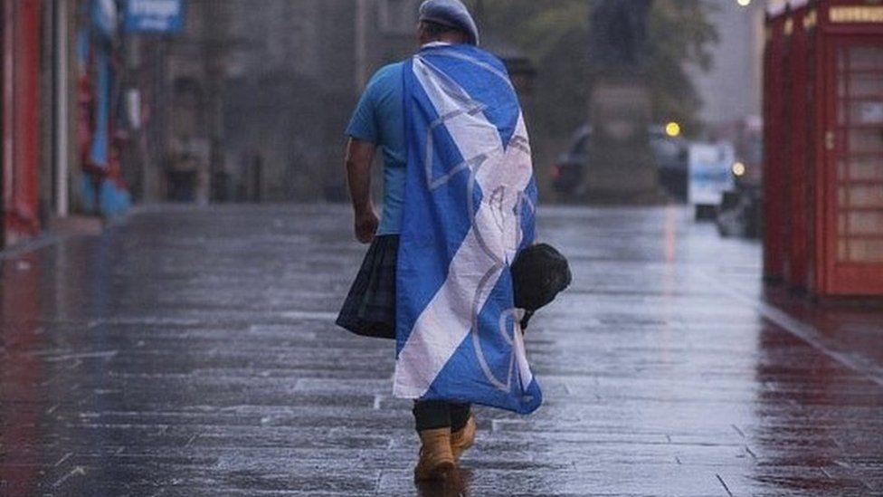 Scottish independence supporter walking along Edinburgh's Royal Mile after 2014 vote